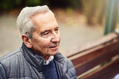 Buy stock photo Cropped shot of a senior man sitting alone at the park
