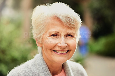Buy stock photo Cropped shot of a senior woman sitting alone at the park