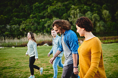 Buy stock photo Cropped shot of a group of friends outdoors