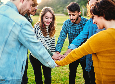 Buy stock photo Cropped shot of a group of friends hands stacked on top of each other in unity outdoors