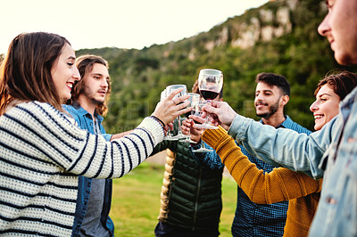 Buy stock photo Cropped shot of a group of friends toasting outdoors