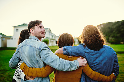 Buy stock photo Rearview shot of a group of friends walking outdoors