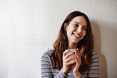 Buy stock photo Shot of an attractive young woman drinking coffee at home