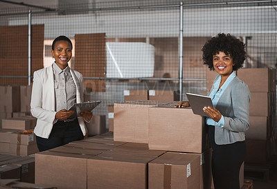 Buy stock photo Cropped portrait of two attractive young female factory managers taking stock in one of their warehouses