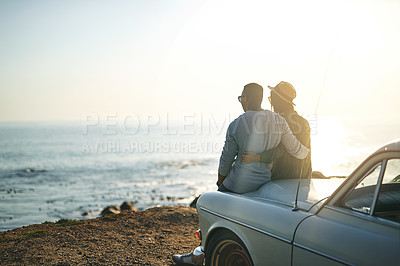 Buy stock photo Shot of a young couple making a stop at the beach while out on a roadtrip