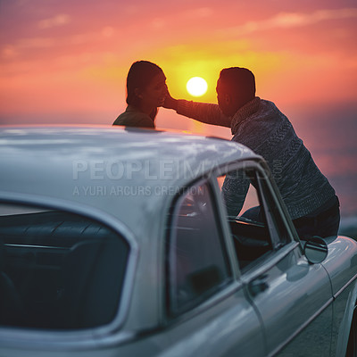 Buy stock photo Shot of a young couple making a stop at the beach while out on a road trip