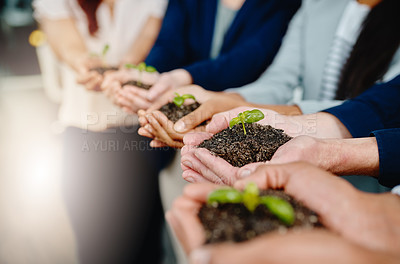Buy stock photo Closeup shot of a group of businesspeople holding plants growing out of soil