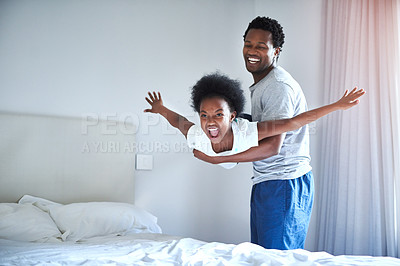 Buy stock photo Cropped shot of a handsome young man and his little girl playing at home