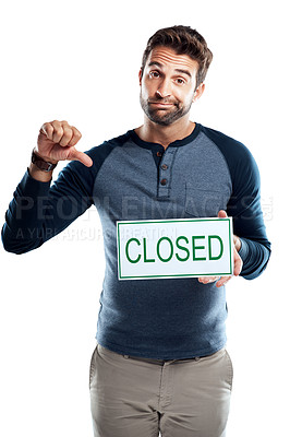 Buy stock photo Studio portrait of a handsome young man holding a closed sign against a white background