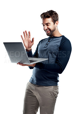 Buy stock photo Studio shot of a handsome young man using a laptop and waving against a white background