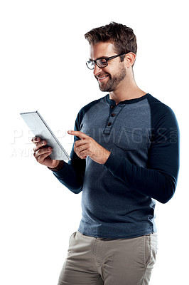 Buy stock photo Studio shot of a handsome young man using a digital tablet against a white background