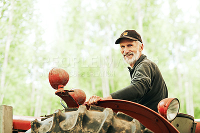 Buy stock photo Portrait of a man operating a tractor on a farm