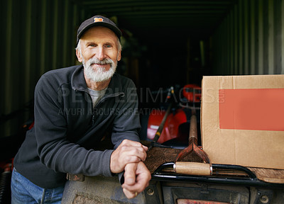 Buy stock photo Portrait of a confident mature man standing in the shed on a farm