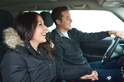 Buy stock photo Shot of a happy young couple out on a road trip