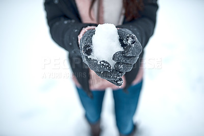 Buy stock photo Cropped shot of an unrecognizable woman holding snow in her hands