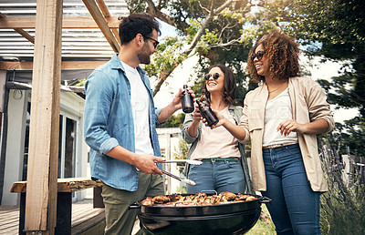 Buy stock photo Shot of a group of friends toasting with beers at a barbecue