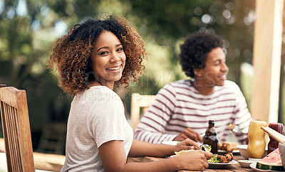 Buy stock photo Portrait of a young woman having a meal with friends outdoors