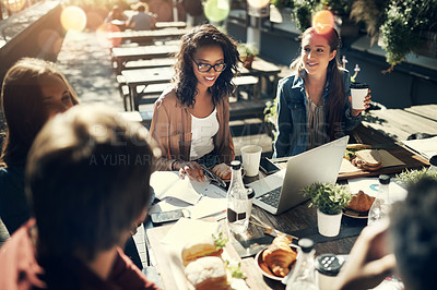 Buy stock photo High angle shot of a group of creative employees having a breakfast meeting outside
