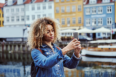 Buy stock photo Shot of an attractive young woman out taking pictures in the city