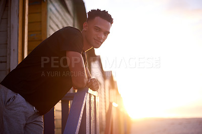Buy stock photo Cropped shot of a handsome young man standing outdoors