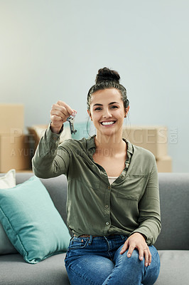 Buy stock photo Portrait of a beautiful young woman holding house keys in her new home