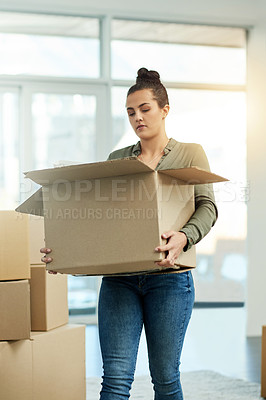 Buy stock photo Cropped shot of a beautiful young woman in her new home on moving day