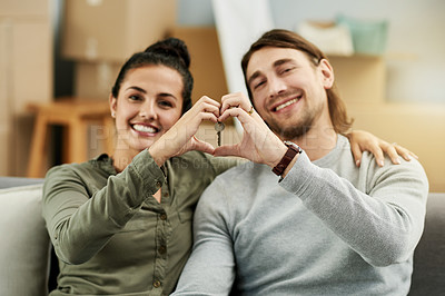 Buy stock photo Cropped shot of a young attractive couple chilling on the sofa in their new home
