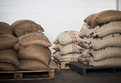 Buy stock photo Still life shot of brown sacks in a warehouse