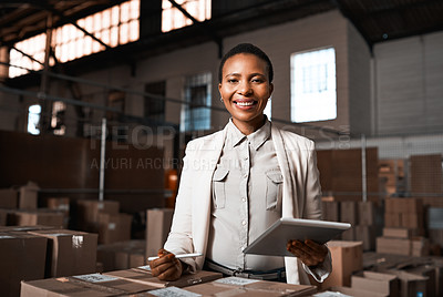 Buy stock photo Portrait of a factory manager using a digital tablet in a warehouse