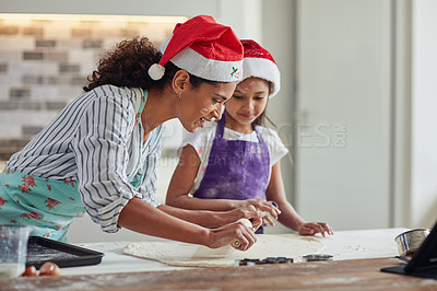 Buy stock photo Cropped shot of a mother and daughter spending quality time while baking at home