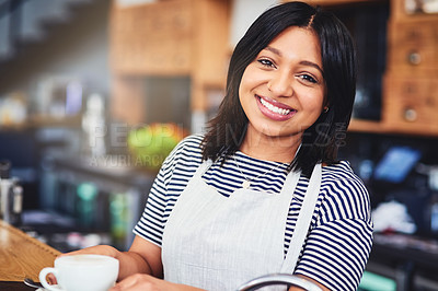 Buy stock photo Portrait of a beautiful young woman working in a coffee shop