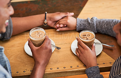 Buy stock photo Cropped shot of an unrecognizable couple having coffee in a coffee shop