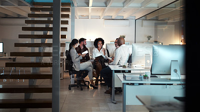 Buy stock photo Full length shot of a group of business colleagues having a meeting in their office