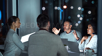 Buy stock photo Cropped shot of a group of business colleagues having a meeting in the office boardroom