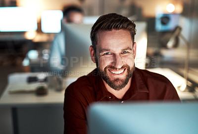 Buy stock photo Cropped portrait of a handsome young businessman working at his desk in the office