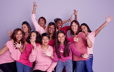 Buy stock photo Studio shot of a group of diverse women wearing pink clothing against a purple background