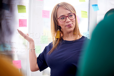 Buy stock photo Shot of a group of young businesswomen having a brainstorming session in a modern office