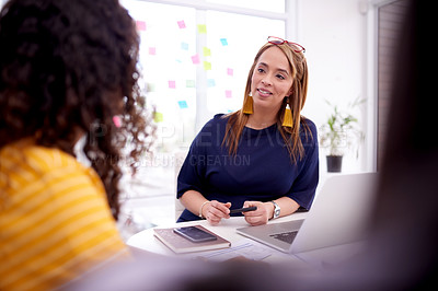 Buy stock photo Shot of businesswomen having a meeting in a modern office