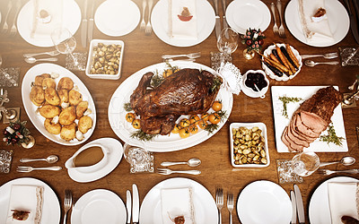 Buy stock photo High angle shot of a feast on a table at Christmas