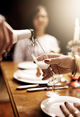 Buy stock photo Cropped shot of an unrecognizable person pouring a glass of champagne at Christmas lunch
