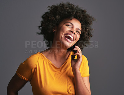 Buy stock photo Studio shot of an attractive young woman using a mobile phone against a grey background