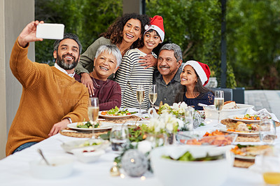Buy stock photo Cropped shot of a happy family celebrating Christmas over lunch