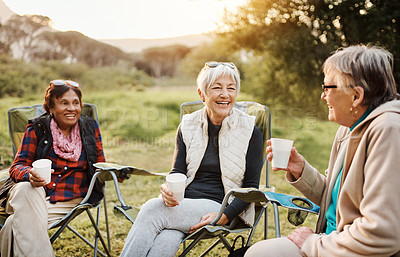 Buy stock photo Cropped shot of a group of happy senior women taking a break during a hike in the great outdoors