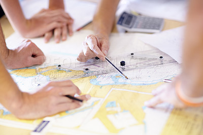 Buy stock photo Cropped shot of a group of unrecognizable male lifeguards finding co-ordinates on a map in their office