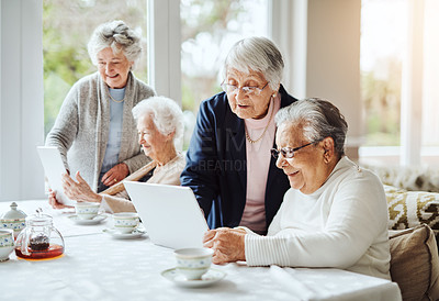 Buy stock photo Shot of a group of senior women using a digital tablet together at a retirement home