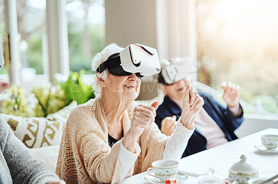 Buy stock photo Shot of happy senior women using virtual reality headsets together at a retirement home