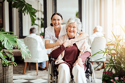 Buy stock photo Portrait of a young nurse embracing an elderly woman in a retirement home