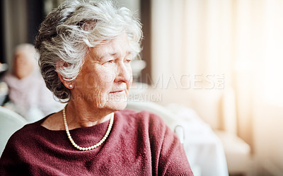 Buy stock photo Shot of senior woman looking thoughtful in a retirement home