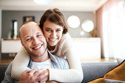 Buy stock photo Portrait of a young couple being affectionate in the living room at home