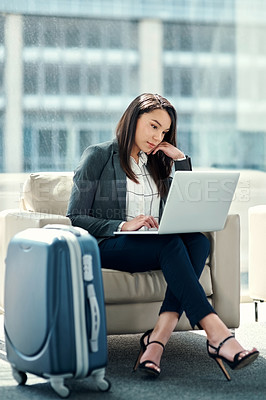 Buy stock photo Shot of a young businesswoman using her laptop in the waiting room on a business trip